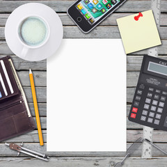 Desk businessman. Chancellery, white sheet and smartphone