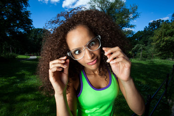 Young Brunette Hispanic woman wearing glasses and making silly f