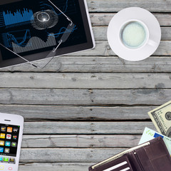 Lie on wooden floor smartphone, tablet and wallet