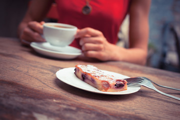 Woman having coffee and cake
