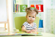 canvas print picture - cute happy little girl reading a book