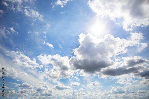 Clouds on sunny sky