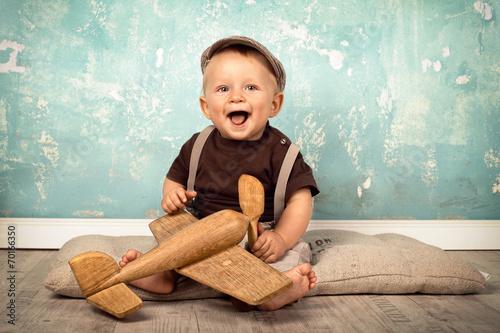 canvas print picture Baby spielt mit Holzspielzeug