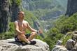 man meditating in lotus position