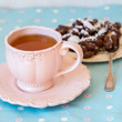canvas print picture - Close up of a cup of tea and chocolate candies