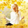 Yoga woman in autumn park