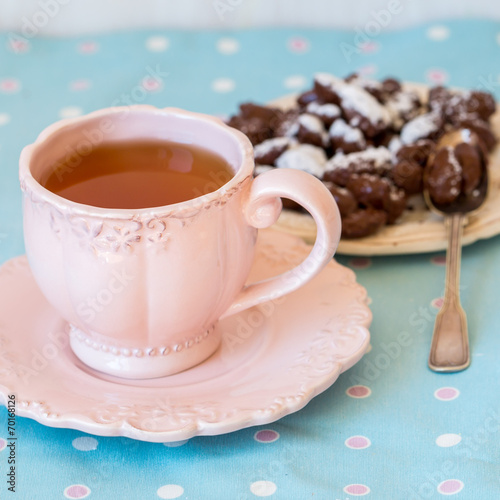 canvas print picture Close up of a cup of tea and chocolate candies