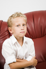 young blond boy on sofa