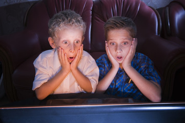 brothers watching scary TV