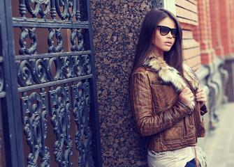 Fashion model wearing sunglasses - outdoor portrait