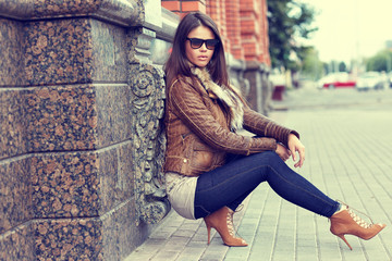 Fashion model wearing sunglasses - outdoor portrait