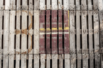 recycled wooden pallets with eight number and rests of painting,