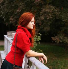 woman on bridge in autumn park