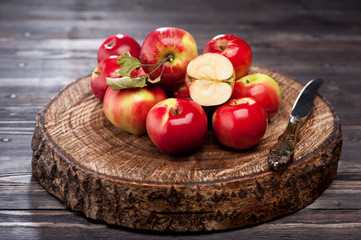 Red apples on wooden board