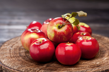 Red apples on textured background