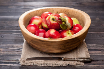 Red apples in rustic bowl