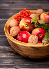 Red apples in wooden bowl.