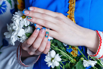Female hands with flowers