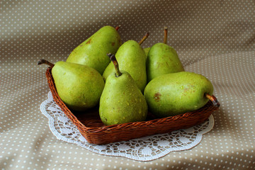 Green pears in a basket.