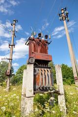 Power transformer against the blue sky background