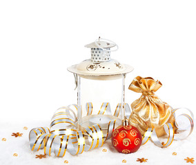Red christmas ball, golden bag with gifts and the old vintage la