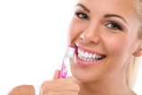 Woman brushing teeth holding toothbrush - 70170106