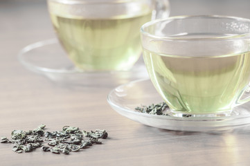 green tea with leaves on the table