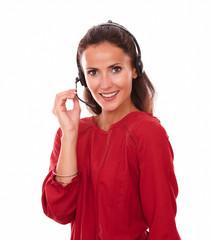 Lovely adult secretary speaking on headphones