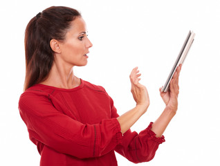 Attractive young lady using her tablet pc