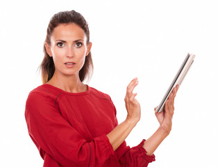 Surprised adult lady working on her tablet pc
