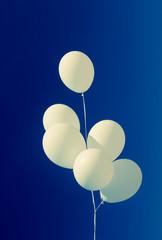 white baloons