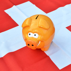 Piggy bank on the Swiss flag