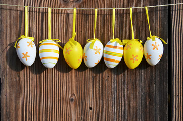 Row of easter eggs along wooden wall