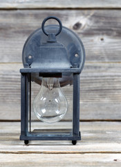 Vintage Outdoor Light on Weathered Wood