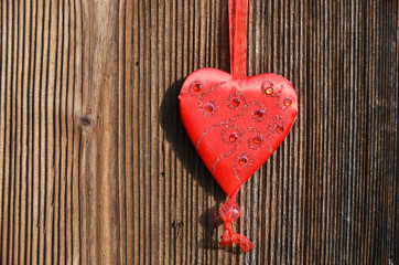 Red heart on the wooden wall