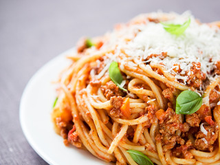 Spaghetti bolognese with parmesan and basil