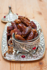 dates in a metal plate with ornament