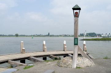 Light Beacon on the jetty in the river The Waal.