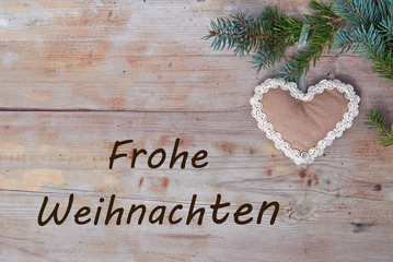 Merry Christmas greetings with handicraft gingerbread - german
