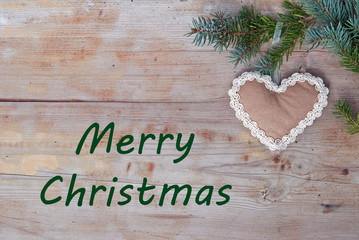 Merry Christmas greetings with handicraft gingerbread heart