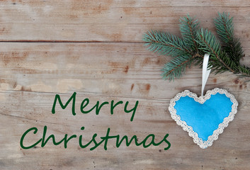 Merry Christmas greetings with handicraft blue heart