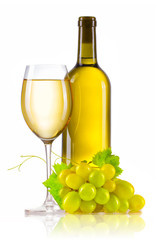 Glass of white wine with bottle and ripe grapes isolated