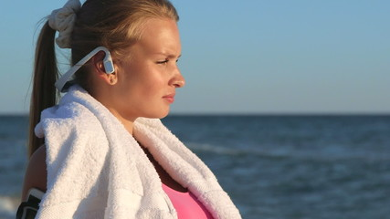 Face of fitness girl relax listening to music after workout