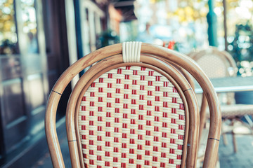 Empty chair outside a cafe