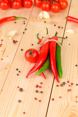 Hot chili pepper on wooden texture.