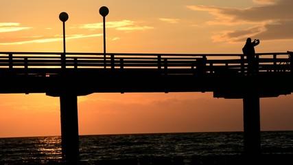 Fotograf auf Seebrücke