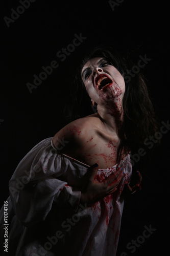 canvas print picture Psychotic Bleeding Woman in a Horror Themed Image