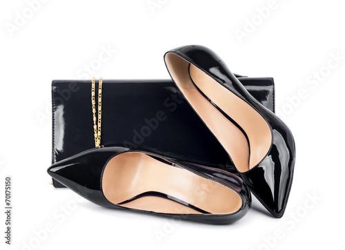 Beautiful  black shoes with clutches on white isolated backgroun - 70175150