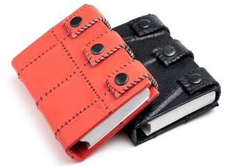 orange and black leather notebooks