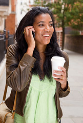 woman with phone and coffee